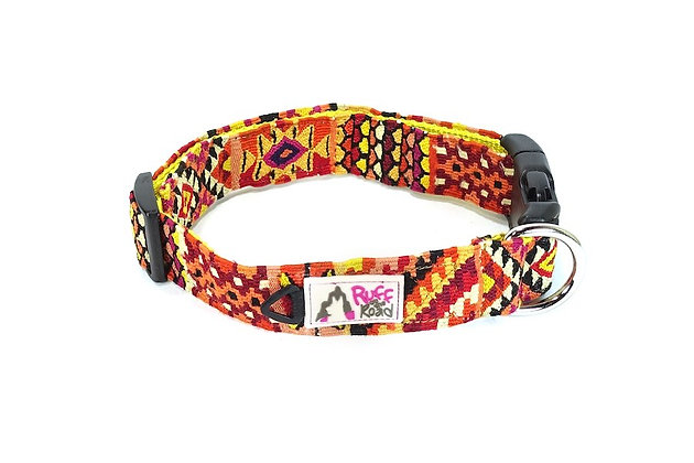 Medium size handmade dog collar in rich orange, red, and yellow hues