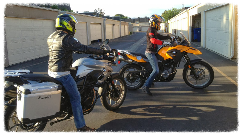Greg and Jess ride their new motorbikes