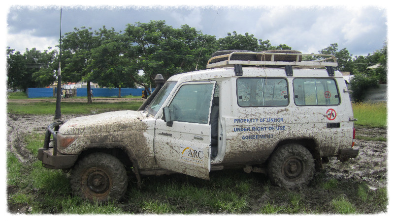 Land Cruiser at drive through the mud