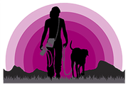 Silhouette of woman wearing camera strap and crossbody bag walks with dog into pink sunset