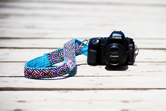 Handmade macrame strap in turquoise, blue, and yellow connected to Canon camera