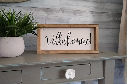 Velbekomme Sign