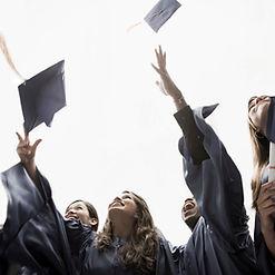 graduation students throwing hats