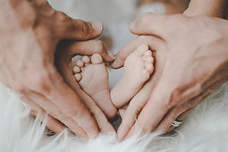 Canva - Person Holding Baby's Feet.jpg