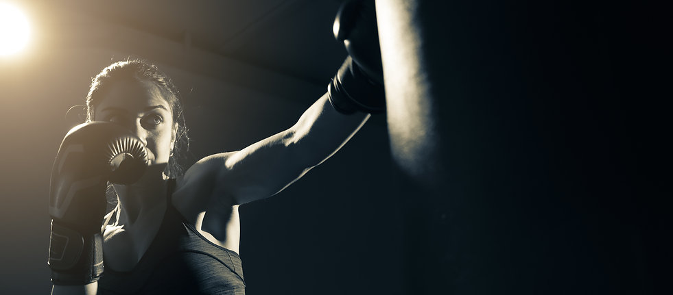 Young woman doing boxing training at the