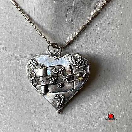 Closed Silver Heart Locket on Model