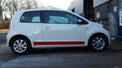 White car with red stripe