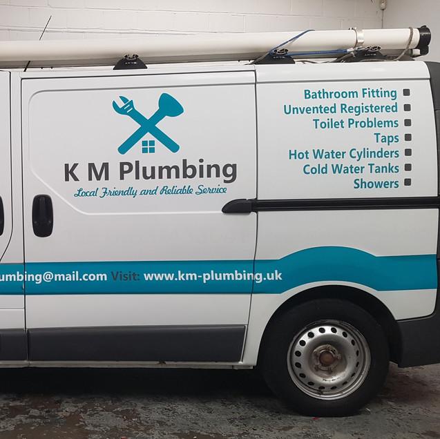 K M Plumbing van