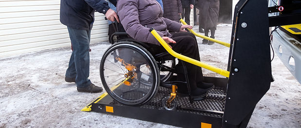 Winter. A woman in a wheelchair on a lif