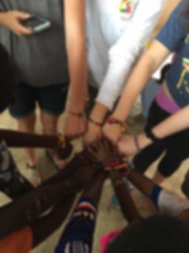 Kids hands together.jpg