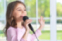 Beautiful little girl with microphone .j