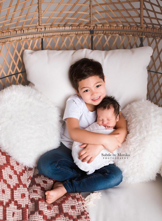 newborn session siblings boys