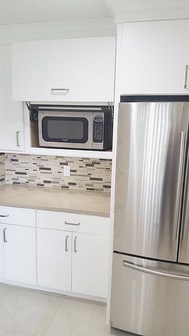 Hidden microwave cabinet in Orlando kitchen remodel