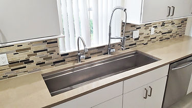What two faucets at a kitchen sink looks like