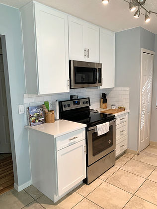 Installed taller wall cabinets in this townhome kitchen