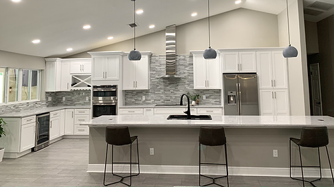 See our completed kitchen remodel in Orlando with a large island, white cabinets and a soffit removal.