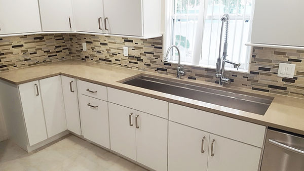 Custom trench sink with two faucets in kitchen