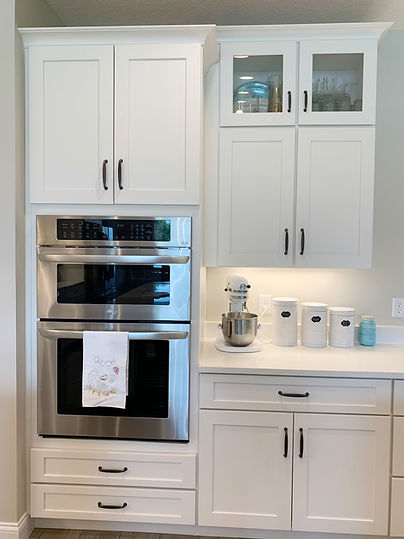 Example of a double oven cabinet with stacked wall cabinets