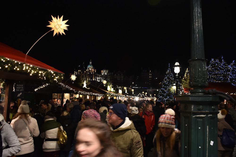 Busy crowds enjoying the Edinburgh Christmas Market