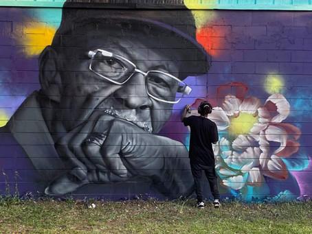 Mr. Earnest Mural Placed on Back of Voo Swar
