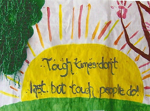 Phot of art poster that says Tough times don't last but tough people do! Written n a painted sun next to a tree and paint handprints.