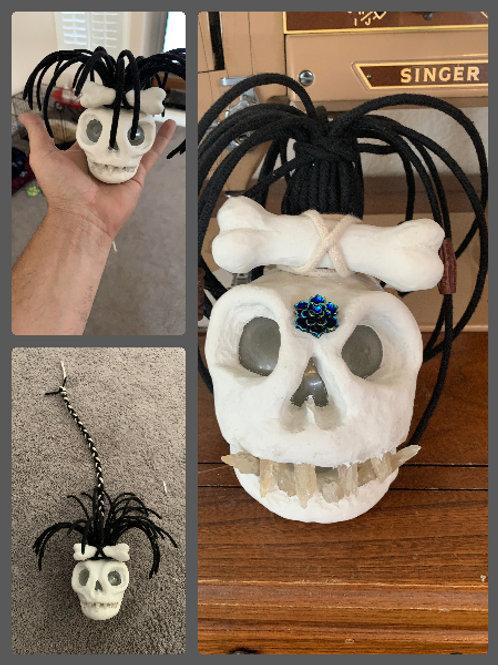 Weetcha shrunken skull scuplture