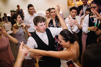 Bride and Groom Dancing with guest