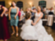 Bride dancing with child
