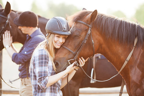 Woman hugging horse and expressing joy a