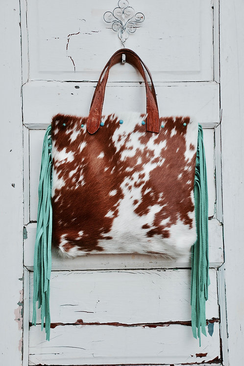 Brown and White Cowhide and Fringe Purse