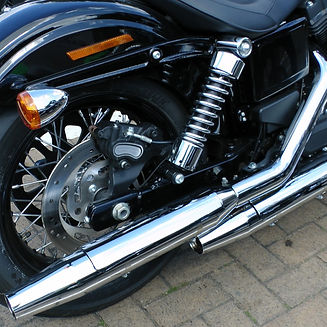 motorcycle exhaust and wheel