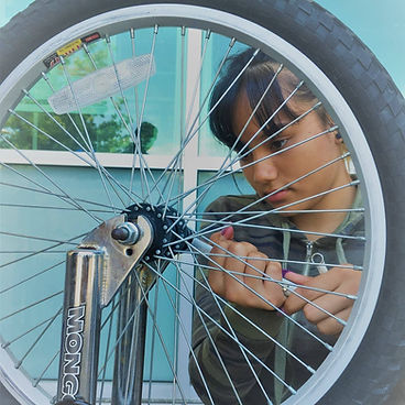 girl fixing bike.jpg