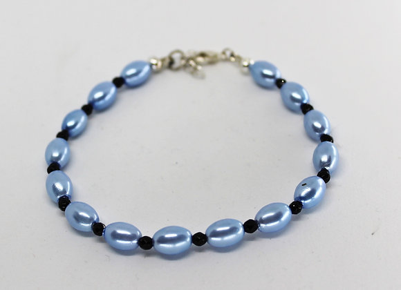 Blue shell pearl and black Spinel.