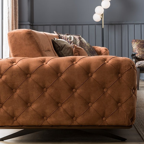 buttoned sofa.couch.sofa.living room.lounge room.tufted sofa.furniture.