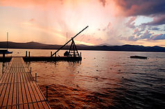 Picture of a rope swing on a dock at sunset
