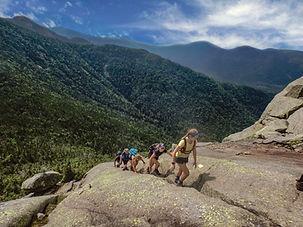 teens hiking up a mountain