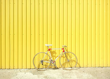 Bike Against a Yellow Wall