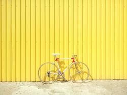 Bike Against a Yellow Wall