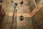 Slate look shower in earth tones