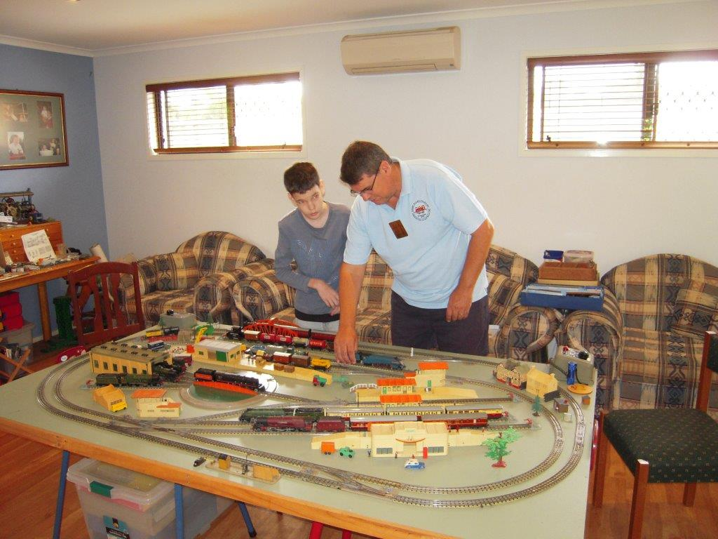 Father and son playing trains.