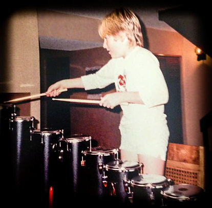 Sean Reienrt playing drums as a child