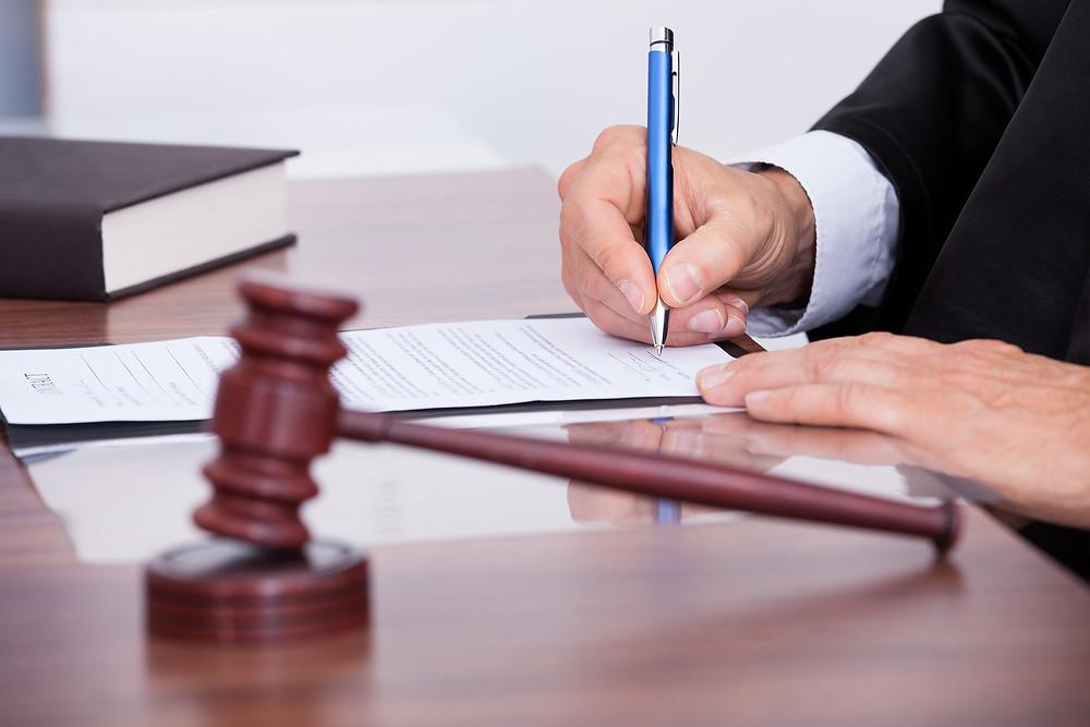 Male Judge Writing On Paper.jpg