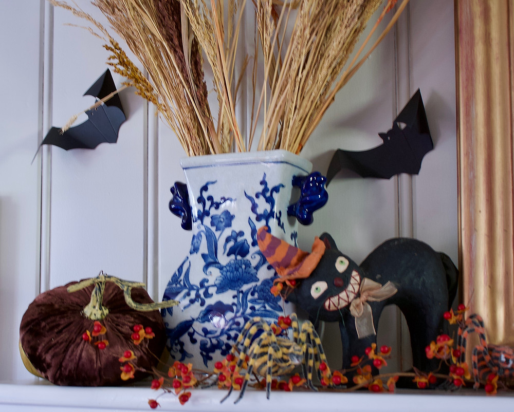 I enjoy decorating with older, gathered pieces that have a memory or some sort of meaning attached.  I love this black cat.  It was the first Halloween decoration I bought when I was a newlywed 27 years ago.  The cat's face reminds me of my husband's (Mr. O) face when he learned that we would be decorating for Halloween!