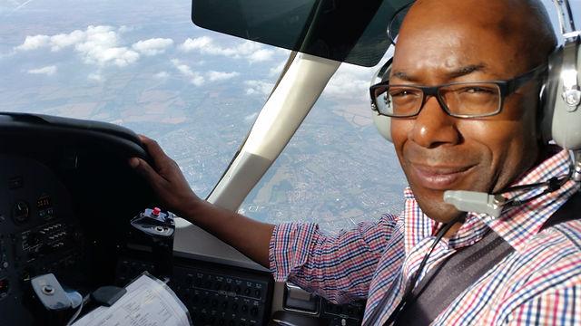 Director - Patrick Nandu Piloting an aircraft.