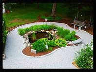 Boss Landscape Company cobblestone water pond blackstone, ma
