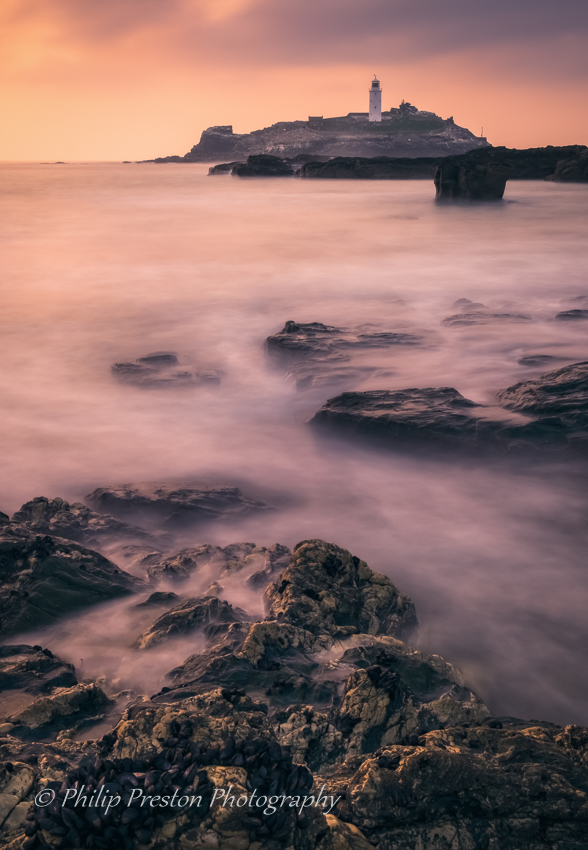 Sunset at Godrevy Point Lighthouse.