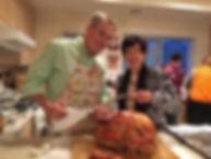 Nov Thanksgiving w mom carving turkey.jp