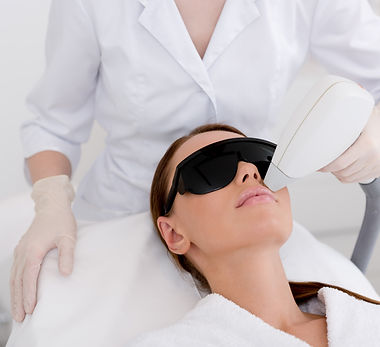 partial view of young woman receiving laser hair removal epilation on face in salon.jpg