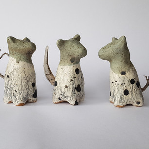 Penny Ruthberg Ceramic dogs with sticks