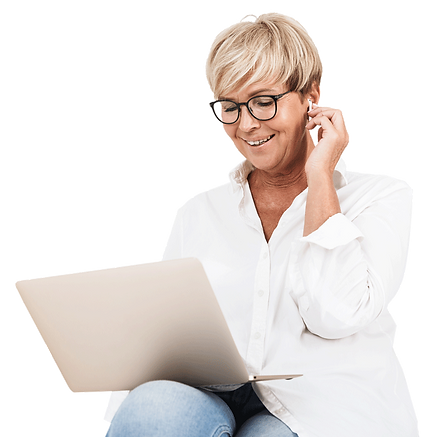 A vacation rental property manager takes a call for a direct guest booking while smiling down at her laptop